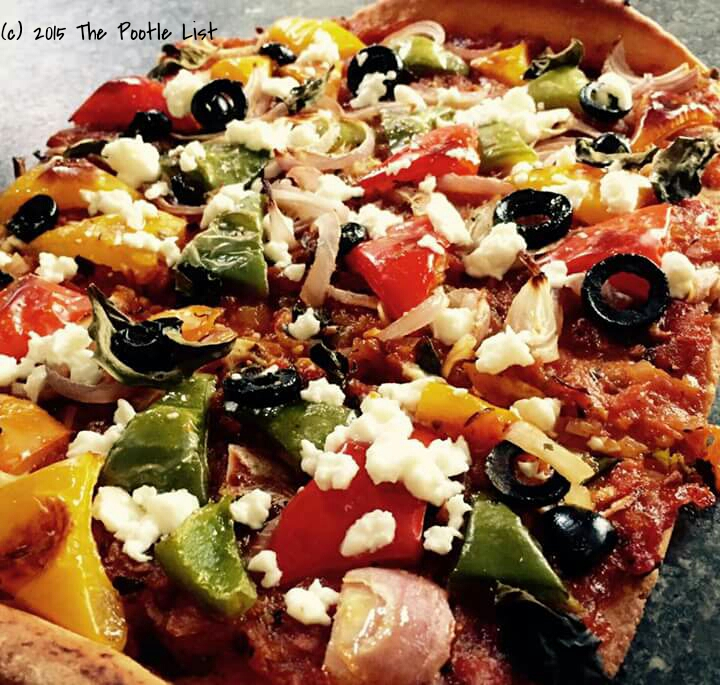 Whole wheat pizza with bell peppers and Feta